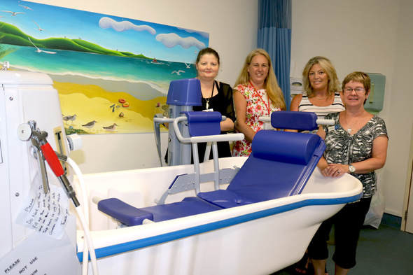 Middlemore Hospital Staff with Bolero Bath Lift Trolley for National Burns Centre will help children with burns