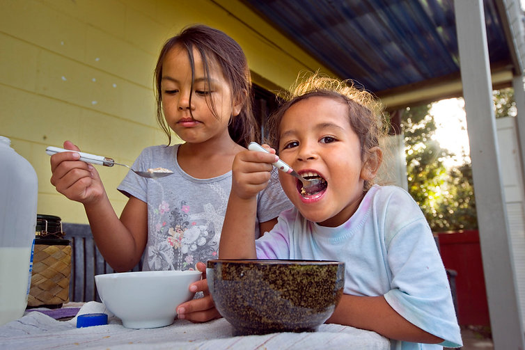 Two sisters eating food in south auckland