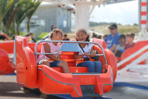 two girls on a ride at funfest