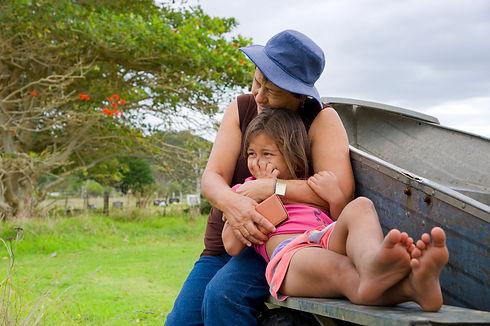grandma cuddling granddaughter