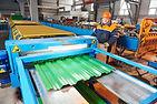 industrial worker operating metal sheet