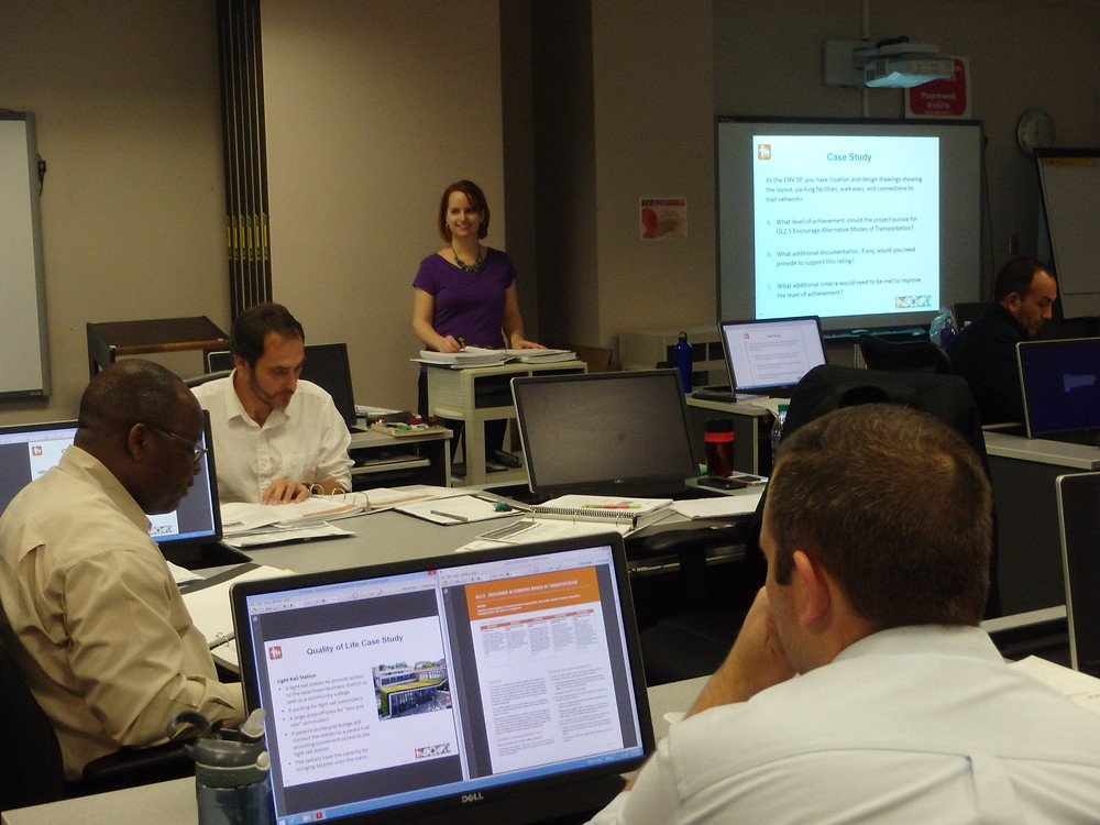 Caption: Jonathan Okafor (left) and Chris Meoli (right) worked on a case study during the Envision training class.