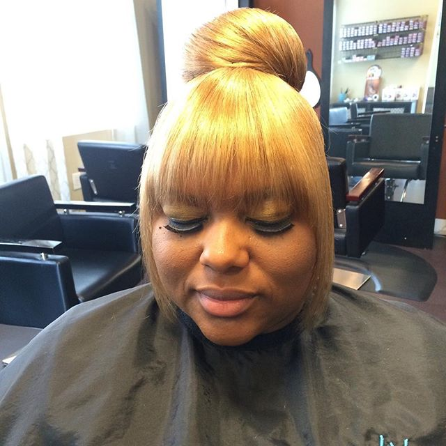 Blonde updo with a bang