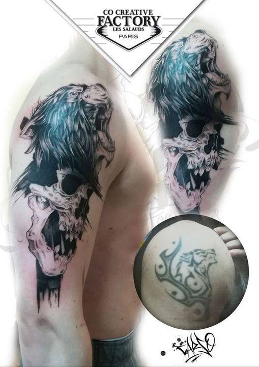 Recouvrement d'un vieux tatouage Lion et