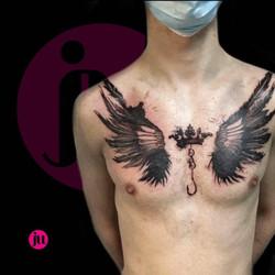 Tatouage ailes sur le torse