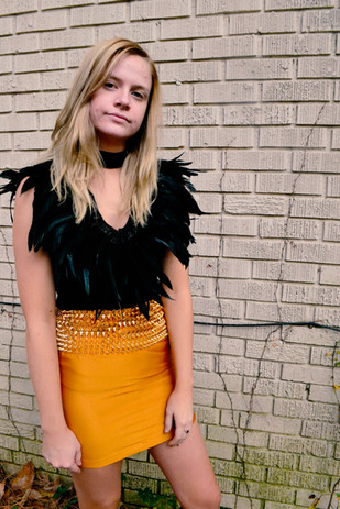 Feathered Blouse   Spiked Skirt