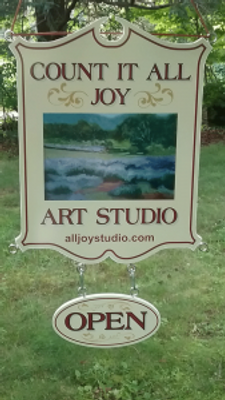 Studio-Sign-169x300.png