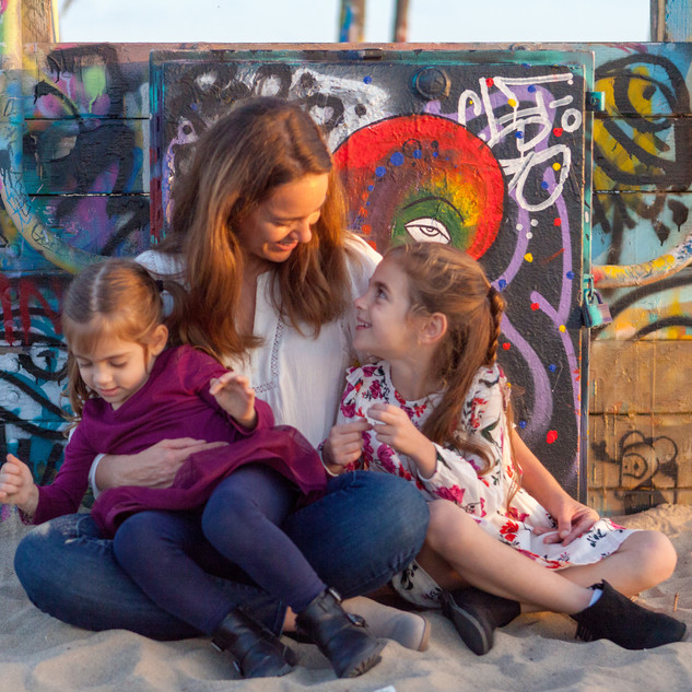 mommy and me daughters sisters children family portrait outdoor on location natural light golden hour graffitti wall beach