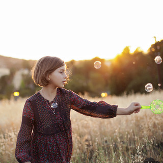 Children portrait candid outdoor on location natural light bubbles golden hour
