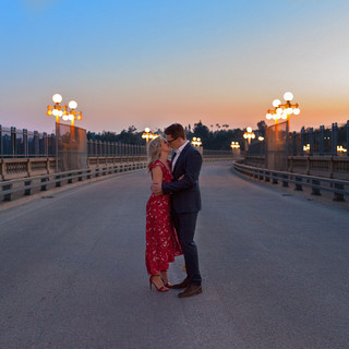 Couples engagement portrait bridge street lamps twilight kiss on location natural light outdoor