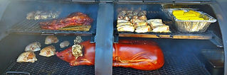 One of our 3 Custom built smokers all filled up with a whole hog, an lots of chicken