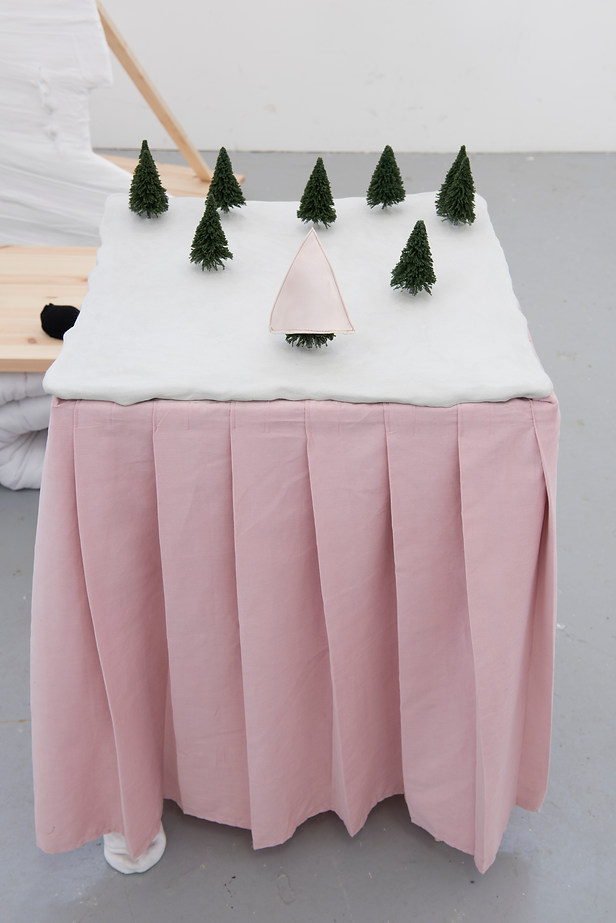 Composition of trees on a table with a pink skirt, 2015