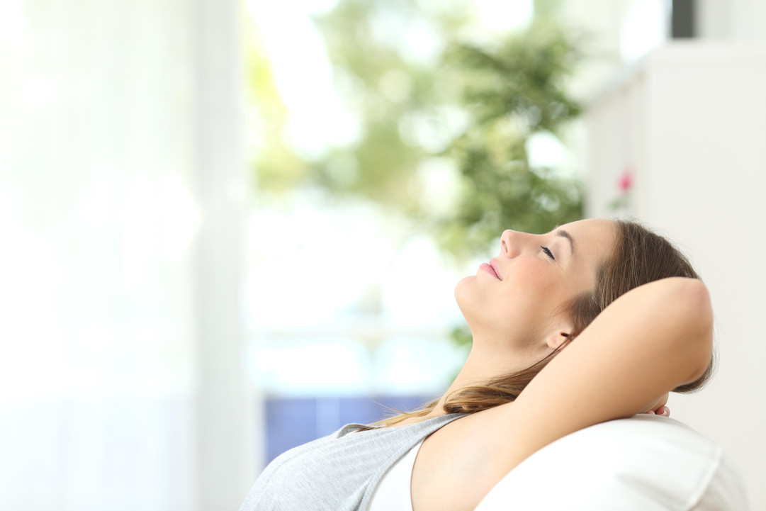 bigstock-Woman-Relaxing-Lying-On-A-Couc-