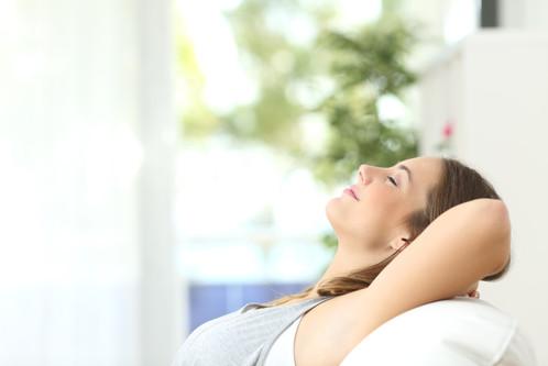 bigstock-Woman-Relaxing-Lying-On-A-Couc-