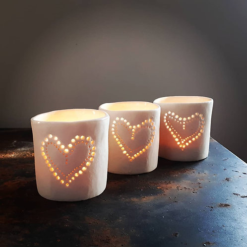 Pierced candleholders