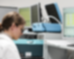 Female laboratory assistant using scientific equipment and software for methods development
