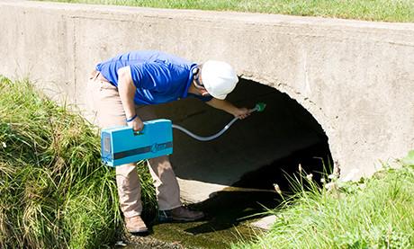 Field Technician Monitoring Mercury in Culvert Using the RA-915M Mercury Analyzer