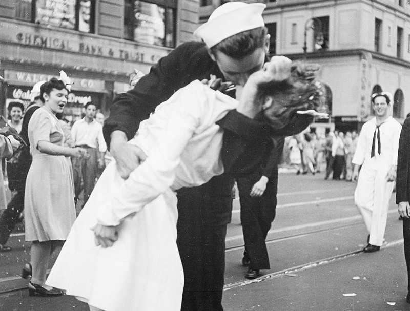 A Navy seaman kisses a woman in Times Square on 14 August, 1945, Victory in Japan day.