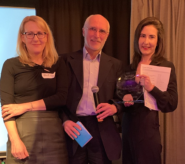 From from left to right: Vanessa Boddington (VitalSource), Alistair McNaught and Eleanor Ricketts collecting the award on behalf of Palgrave Macmillan.