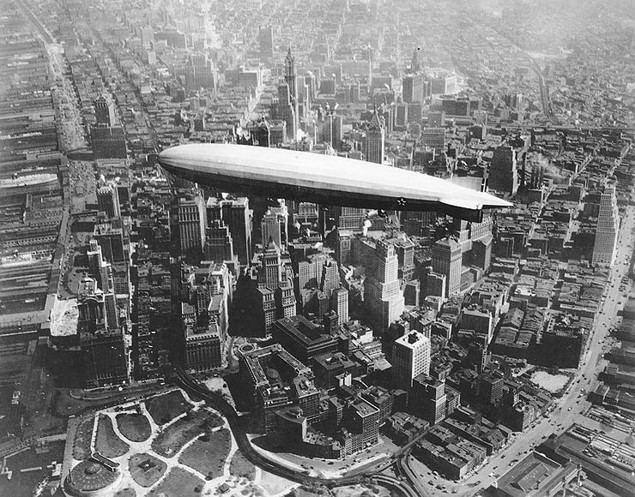 The U, S, S Los Angeles zeppelin flies high above the skyscrapers of Manhattan, New York City, 1930.