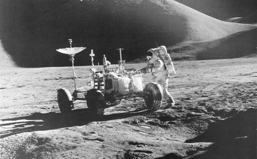 Astronaut James B. Irwin, Lunar Module pilot, works at the Lunar Roving Vehicle during the first Apollo 15 lunar surface extravehicular activity at the Hadley-Apennine landing site on the moon, 31 July 1971.