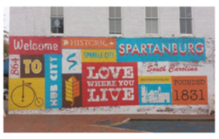 "​A colorful mural entitled ""Love where you live"" in Spartanburg, South Carolina."