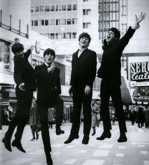 The Beatles jump for joy on a high street in Stockholm in 1963.