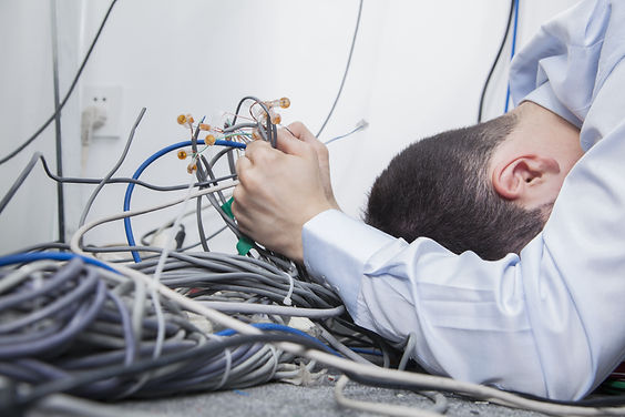 Frustrated man lying down trying to figu