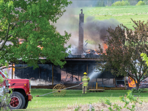 Three fire departments battle house fire