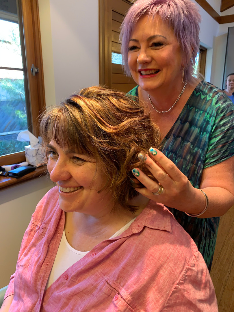 Cath looks rightly pleased with her new do.