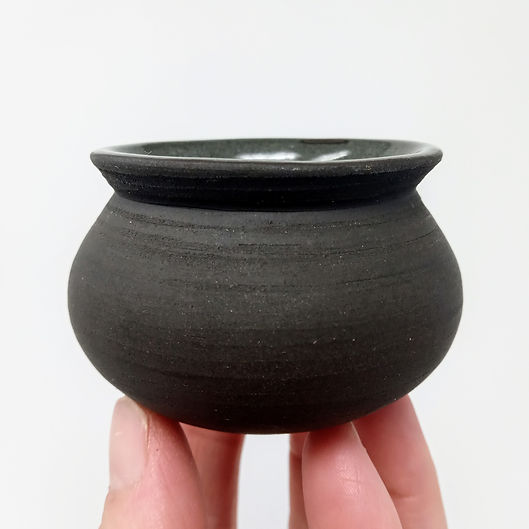 Tiny black clay moon jar, by Clay by Design
