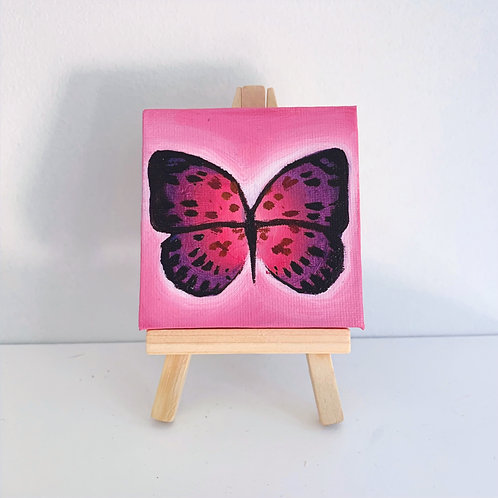 Spotted pink butterfly and stand