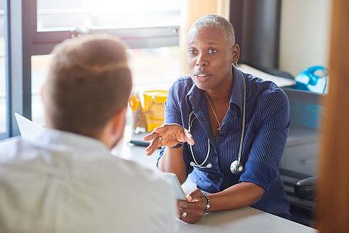 HCP and patient engaged in a discussion in an office