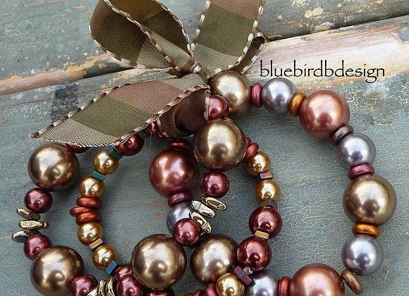 3 shinny stretch bracelets