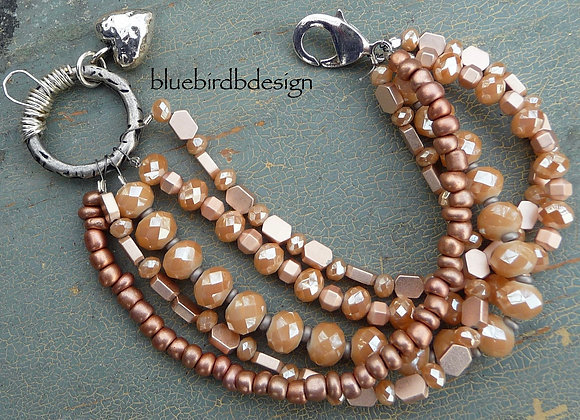 5 strand peach beaded bracelet