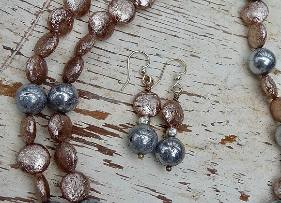 Grey and light pink beaded necklace with coordinating earrings.