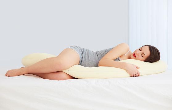 beautiful pregnant woman sleeps comforta