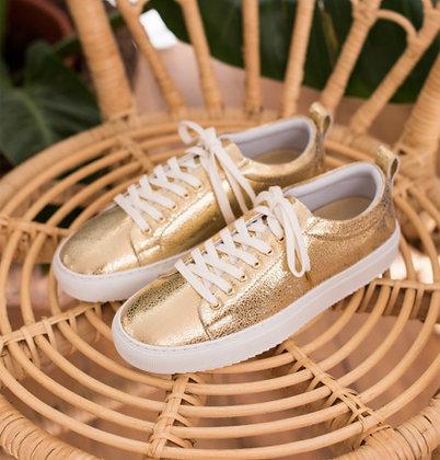 Sneakers en cuir craquelé doré