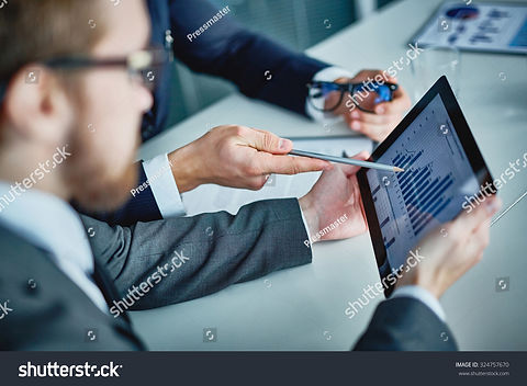 stock-photo-businessman-holding-touchpad