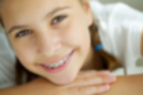 Portrait of teen girl showing dental bra