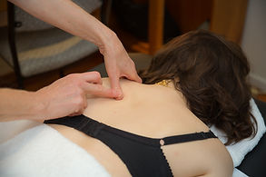 Applying pressure to the shoulder blade
