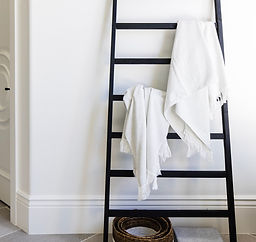 Ladder with blankets leaning on wall