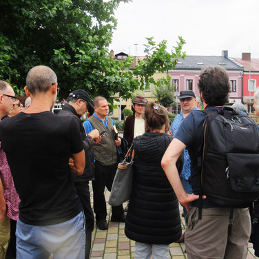 in the main square with Piotr Krawczyk , co author , the story of Jewish Chmielnik