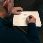 PETER MOORE SKETCHES OF WING LOGO