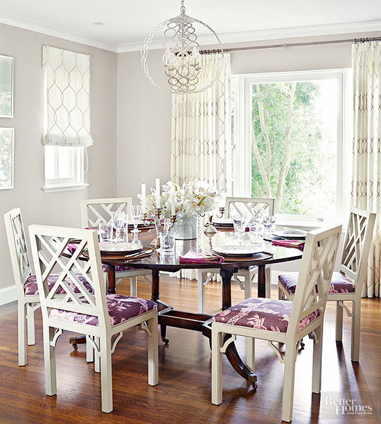 white and gold drapery panels and matching roman shades in a breakfast eating room