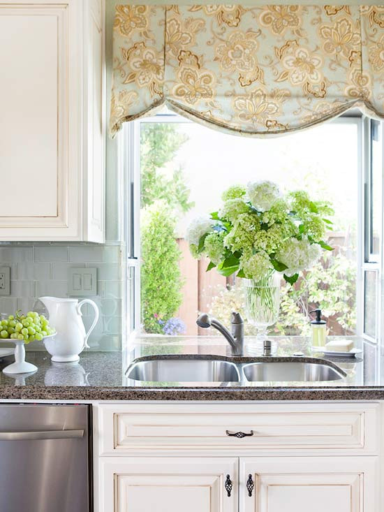 A pleated, relaxed roman shade over the kitchen sink.