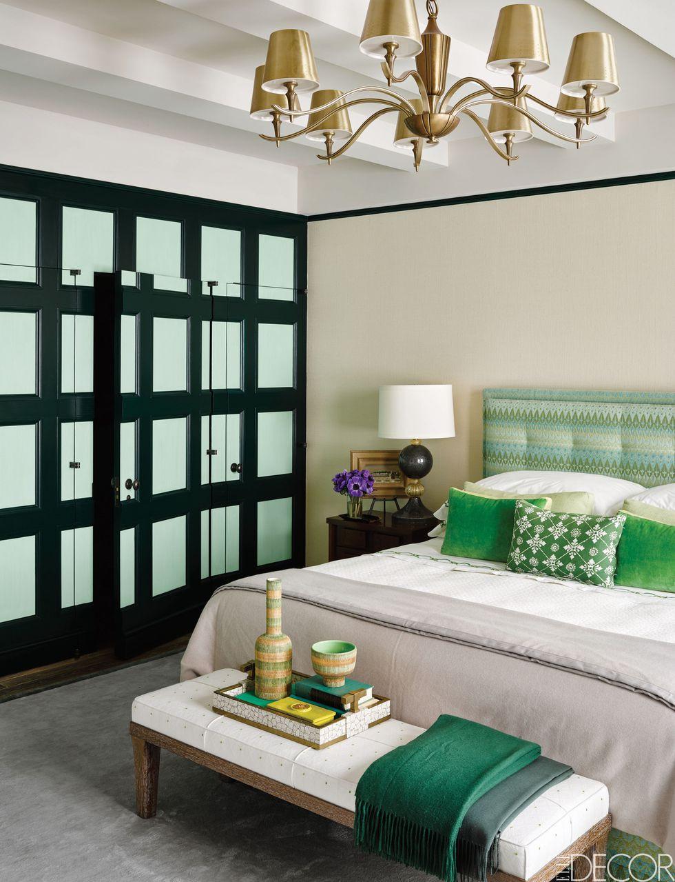 Green throw pillows and a custom green designer headboard