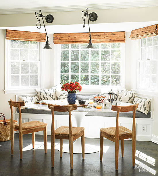 Woven blinds in a kitchen bay window kitchen banquette