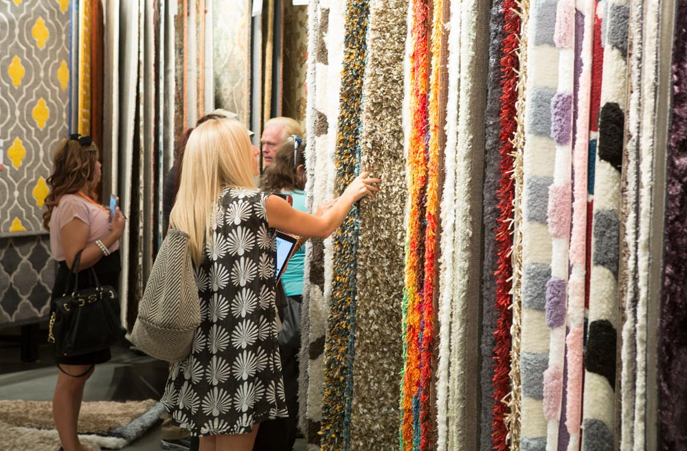 Interior Designers shopping for rugs at a wholesale furniture market in Las Vegas