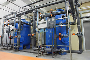 Swimming pool filtration system at basem